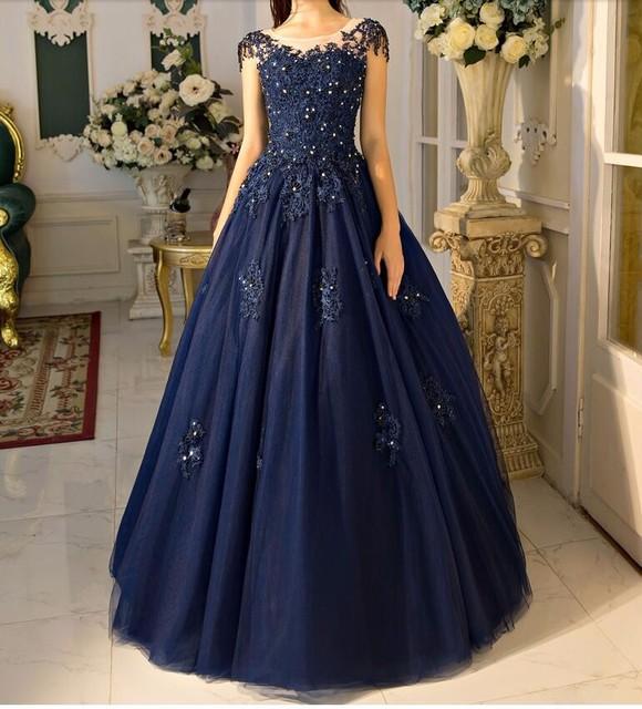 Elegant Navy Blue Ball Gown Prom Dresses 2018 Hot Cap Sleeves Floor Length  Beaded Lace Tulle Prom Gowns Corset Vestido De Festa 15091659e7c6