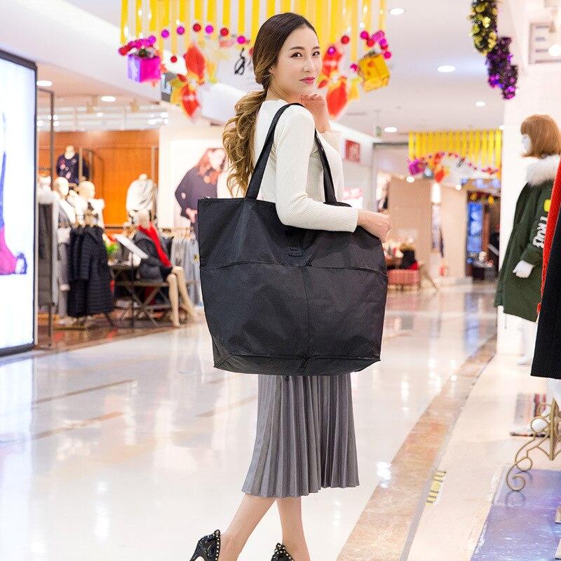 QIUYIN Large Casual Waterproof Travel Bag Clothes Capacity Shoulder Bag Foldable Handbag Duffle Bag Promotion Travel Bag in Travel Bags from Luggage Bags