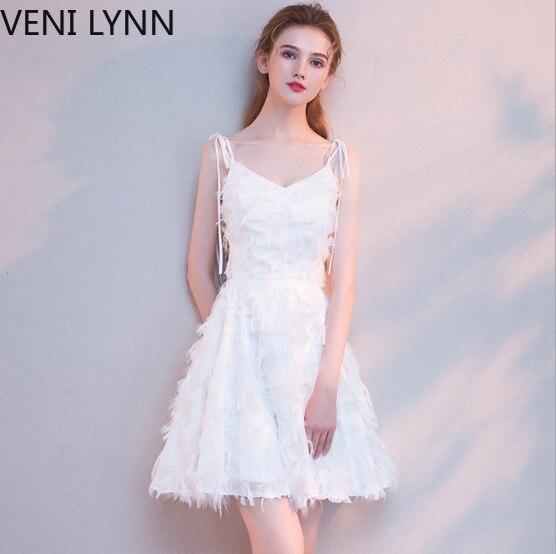 VENI LYNN mode robe blanche femmes dentelle fête sans manches solide Mini filles robes nouveau 2019 haute qualité