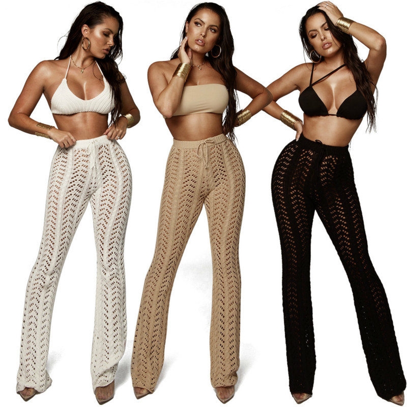 woman Sexy Hollow Out Knitting Trousers Hook Flower Sandy Beach flare pants see through womens clothing white long lace up pants in Pants amp Capris from Women 39 s Clothing
