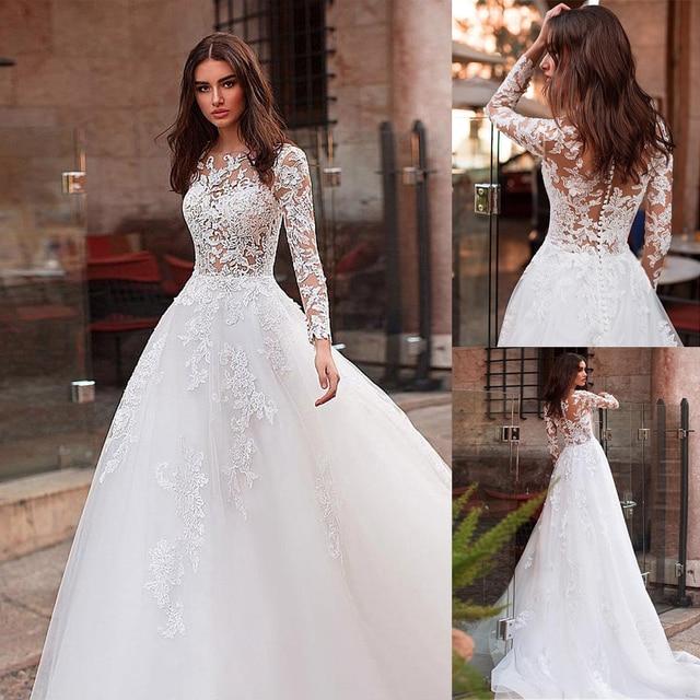 Aantrekkelijke Tulle Jewel Hals See Through Lijfje A lijn Trouwjurk Met Kant Applicaties & Staaflijst Lange Mouwen Bridal Dress