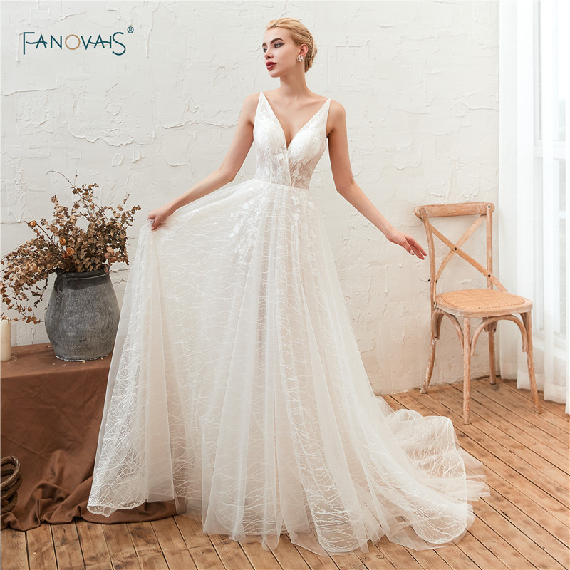 White Ivory Boho Wedding Dresses 2019 V Neck A Line Lace Wedding Gown Long Sexy Beaded
