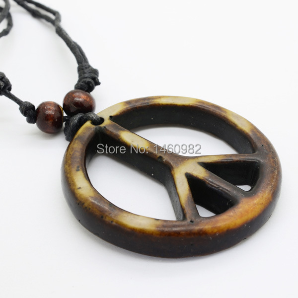 Cool tribal style yak bone carved peace sign pendant necklace cool tribal style yak bone carved peace sign pendant necklace adjustable wood beads rope yn111 mozeypictures Choice Image