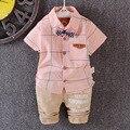 Летом новорожденный костюм детей для мальчиков и девочек 100% хлопка футболку воротник костюм и с бантом + бесплатная доставка два комплекта брюки