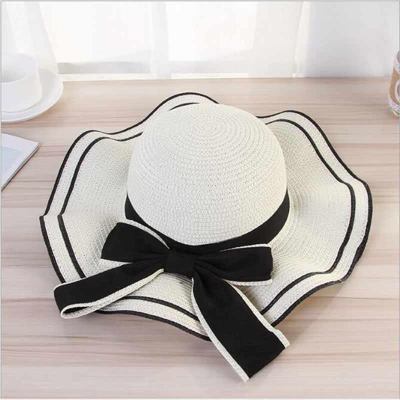Ymsaid ファッション女性夏のカジュアルワイドつば太陽キャップビッグ弓ノット女性休暇ビーチ帽子バイザー女性帽子