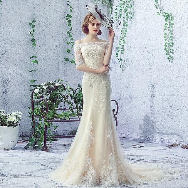 Wedding Dress 2017 New Fashion The Bride Luxury Champagne Lace Half Sleeves Boat Neck Sexy Slim Mermaid  Vestido De Noiva