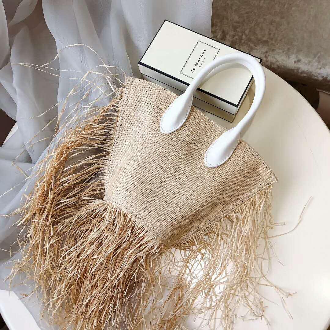 Mode sac de plage nouveau sac à bandoulière populaire gland manuel tissé sac de paille 2019 an qualité artisanat papier vacances tissage sac à main