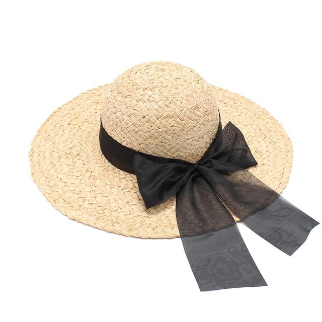 Summer Large Brim Beach Sun Hat For Women Natural Raffia Straw Hats Ladies  Elegant Black Bow 1b61de152f20