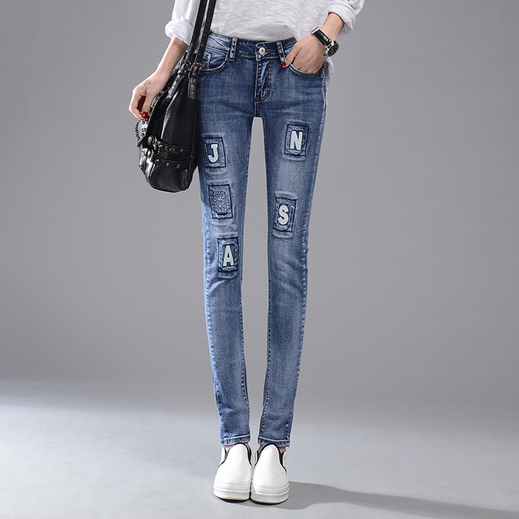 The new spring and summer 2016 Korean women stretch ripped jeans slim denim trousers embroidered letter feet