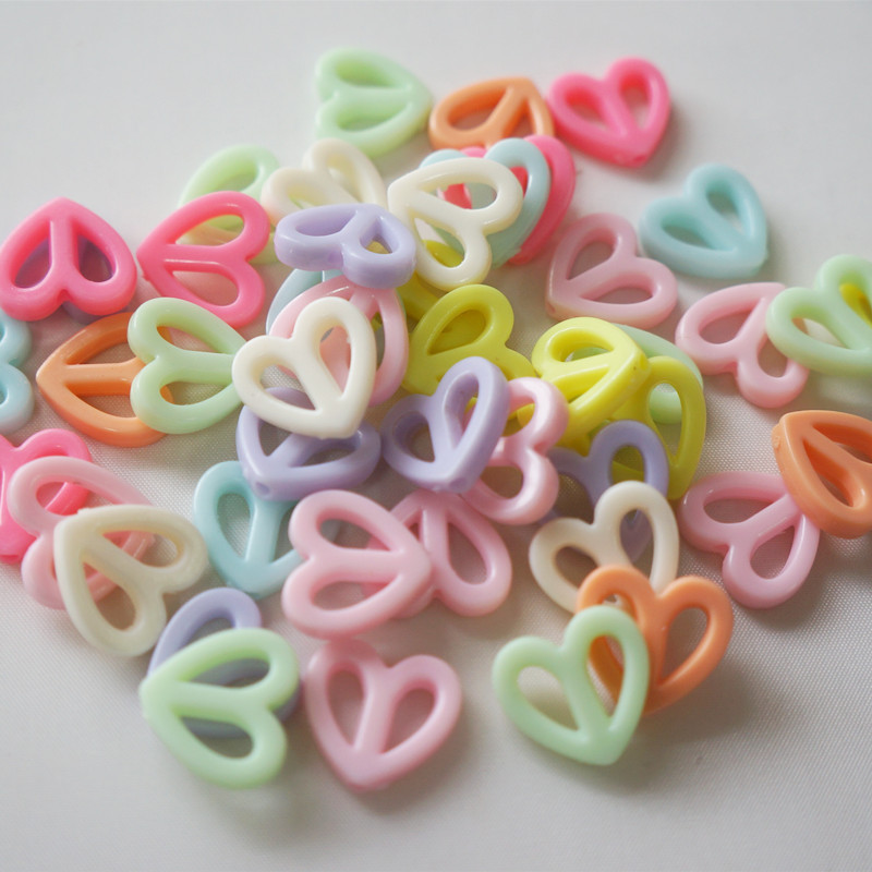 Meideheng Acrylic Hollow out heart shape Circular anti-war sign pink for Childrens jewelry accessories making 17mm 85pcs/bag