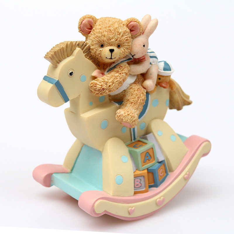 Livraison gratuite belle boîte à musique de cheval à bascule ours, boîte d'octave de cheval de troie de lapin, cadeau de pleine lune de bébé pour l'anniversaire des enfants