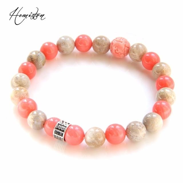Фото браслет из разноцветных бусин thomas с розовым коралловым камнем