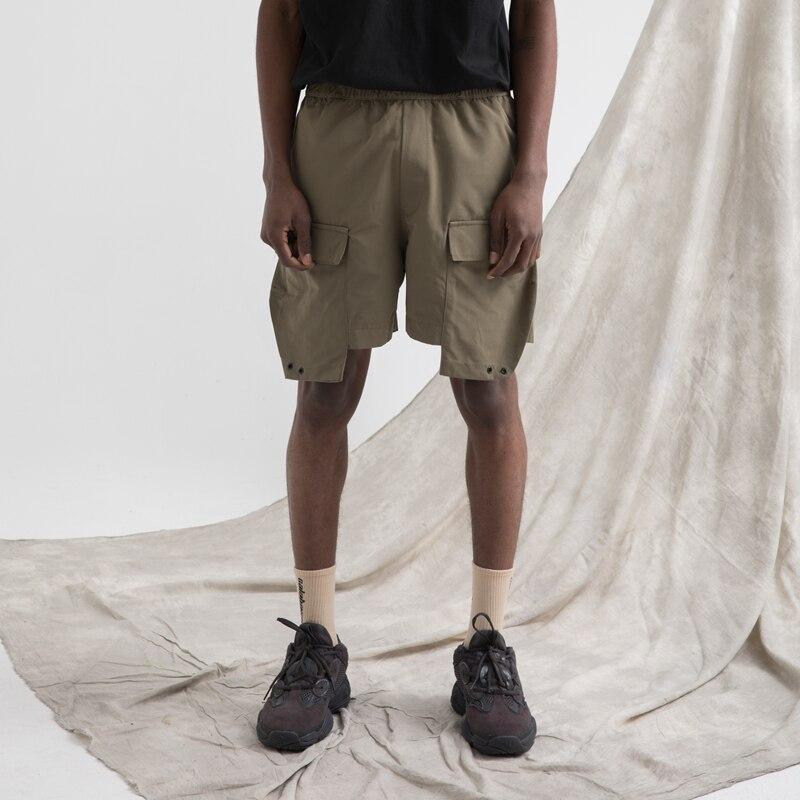 RO style cinq pantalons été nouveau multi-poche militaire uniforme lâche hommes haute rue pantalon hip-hop cinq pantalons