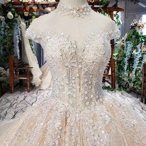 Image 4 - HTL639 brilhantes vestidos de casamento com brilho de alta pescoço cap luva de cristal vestidos de casamento do laço com trem vestidos de novia vindima