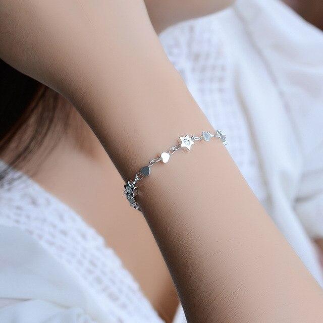 Купить женский браслет из серебра 925 пробы с шармами в виде сердца картинки