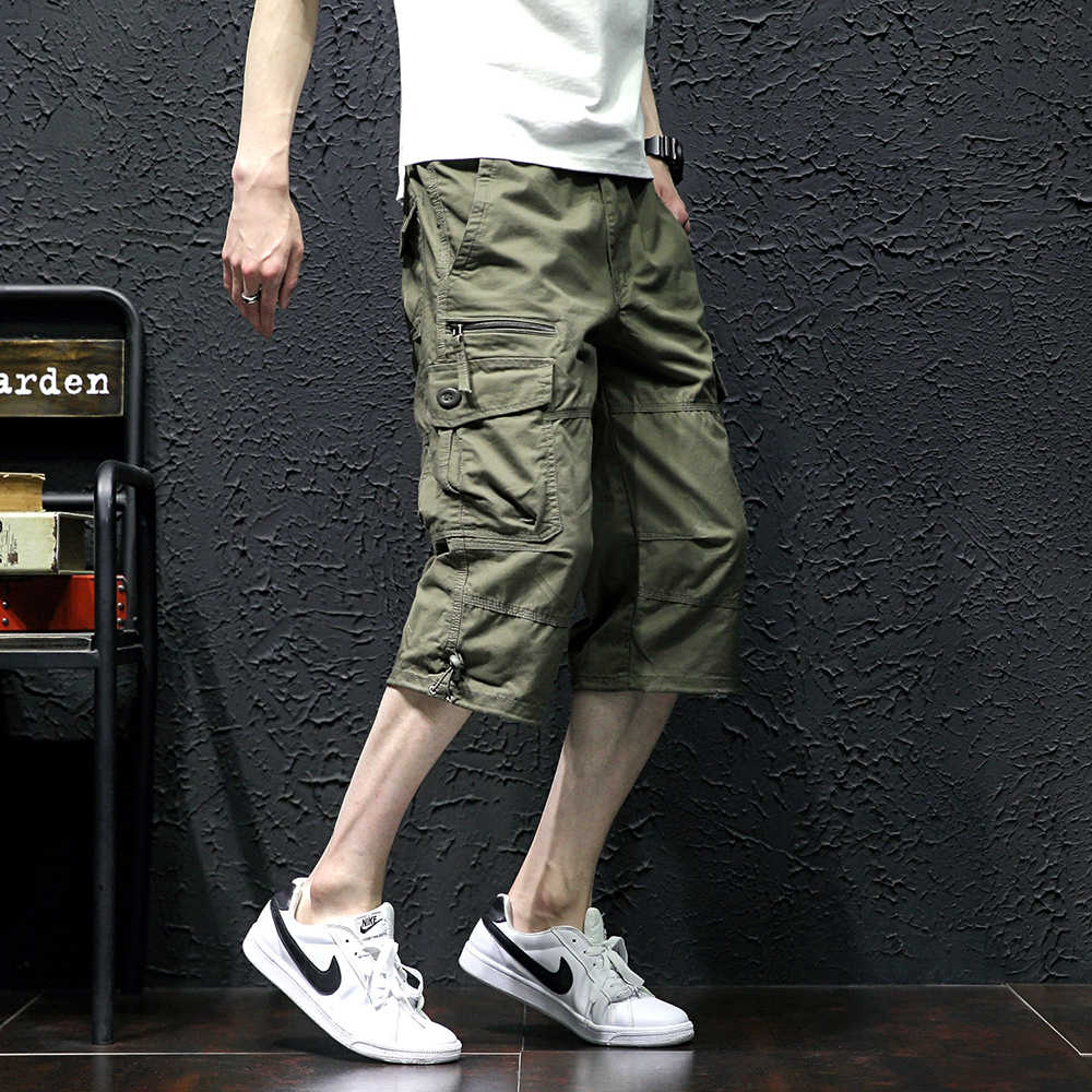 e659dea9c7 ... Men's Casual Twill Elastic Cargo Shorts Below Knee Loose Fit  Multi-Pocket Capri Shorts Summer ...
