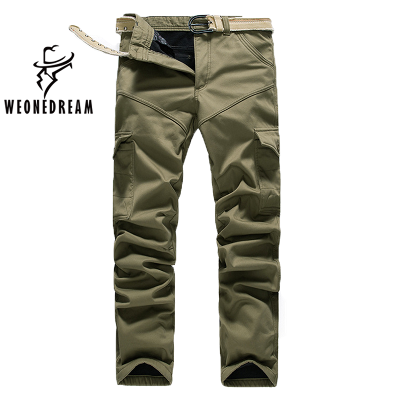 Our Men's Sere Wool Pants are durable, military inspired pants made to wear well and meet an array of needs. Cargo pocket styling includes two quarter top pockets, two thigh cargo pockets with drawcord cinches, two lower leg cargo pockets, and two rear welt pockets with concealed two-button flap closures.