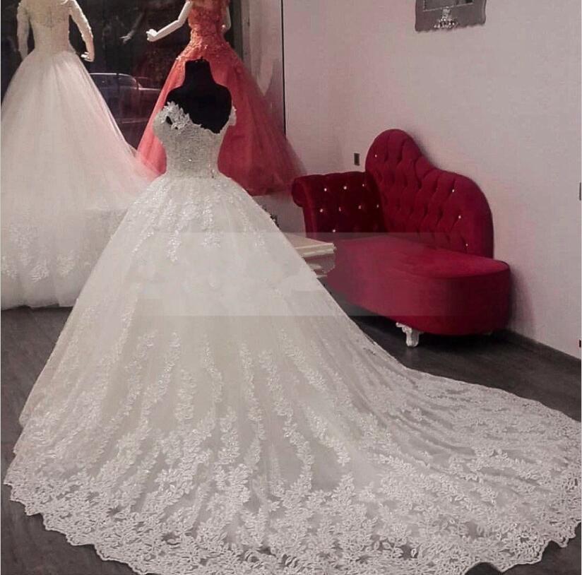 Luxury-Lace-Ball-Gown-Long-Sleeve-Wedding-Dresses-2017-Gelinlik-Sweetheart-Sheer-Back-Princess-Illusion-Applique (1)