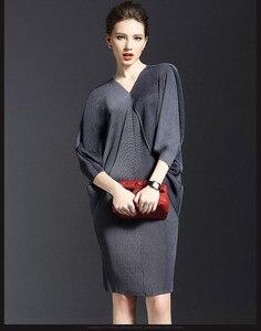 Image 4 - TEXIWAS 2019 en najaar nieuwe temperament V hals vleermuis lange mouw vrouwen tas billen effen kleur fold jurk