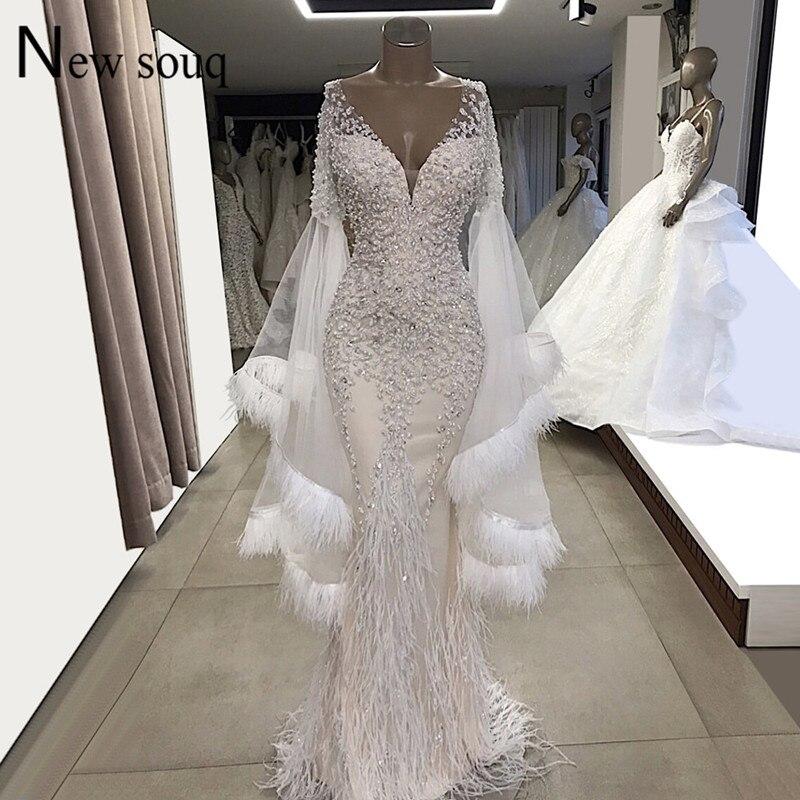 Robes de soirée blanches plumes manches longues sirène robes de soirée de mariage 2019 Couture col en V Tulle perles cristaux robes de bal