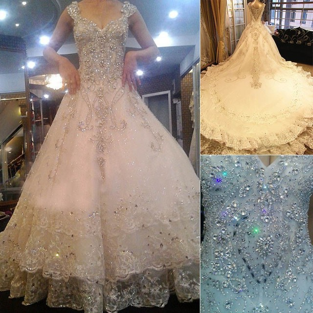 c3bc58649b35f7 Swarovski Crystals Wedding Dresses V-Neck High Quality A-line Cathedral  Train Plus Size Luxury Bridal Gown Vestido De Noiva