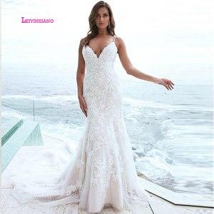 Image 1 - LEIYINXIANG  Luxury Bride Dress 2019 Wedding Dress Vestido De Noiva Sereia Robe Sexy Mermaid BacklessElegant Appliques V Neck