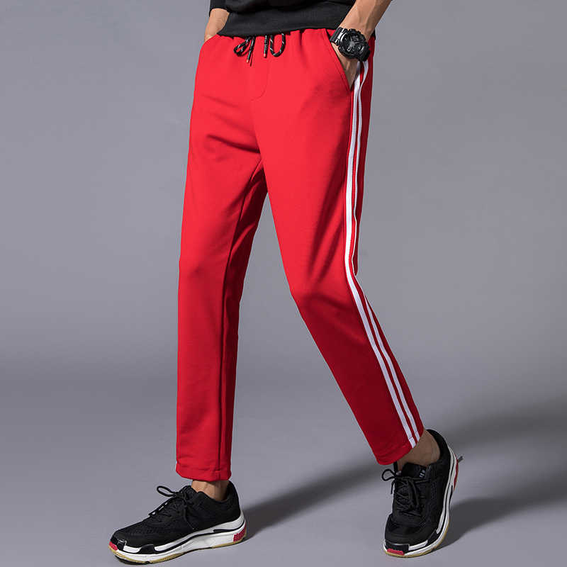 57506010cd Detail Feedback Questions about Side Stripe Pantalones Hombres Fashion  Casual Pants Men Elastic Waist Drawstring Black Red M 5XL Trousers on  Aliexpress.com ...