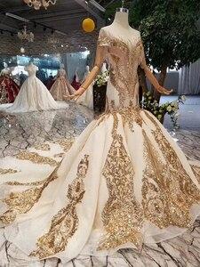 Image 3 - LS22005 luxus meerjungfrau hochzeit kleider mit goldenen spitze oansatz quaste kurzen ärmeln open back trompete robe de mariée sirène