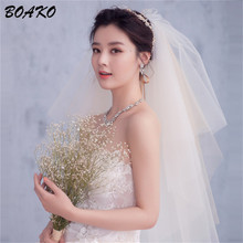BOAKO Cut Edge Puffy Tulle Bridal Veil Fingertip Length Elegant Wedding With Comb 4 Layer White Champagne Velos De Novia