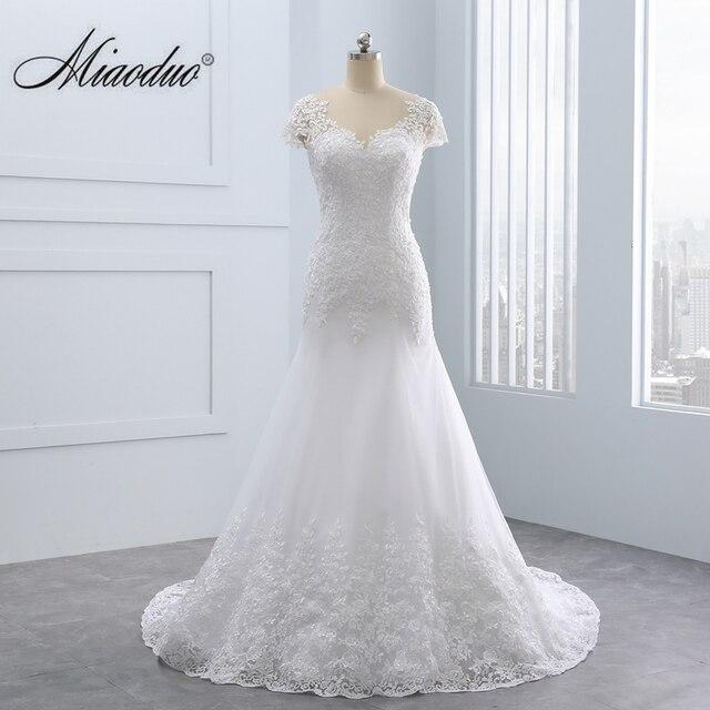 2020 Vestidos de noiva kısa Backless dantel düğün elbisesi es Mermaid aplikler İnciler beyaz gelinlikler artı boyutu düğün elbisesi