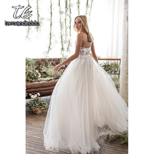 Image 4 - Spaghetti Straps Scoop Wedding Dress Sleeveless 3D Flower Lace Appliques Backless A Line Tulle Illusion Bridal Gown with Train