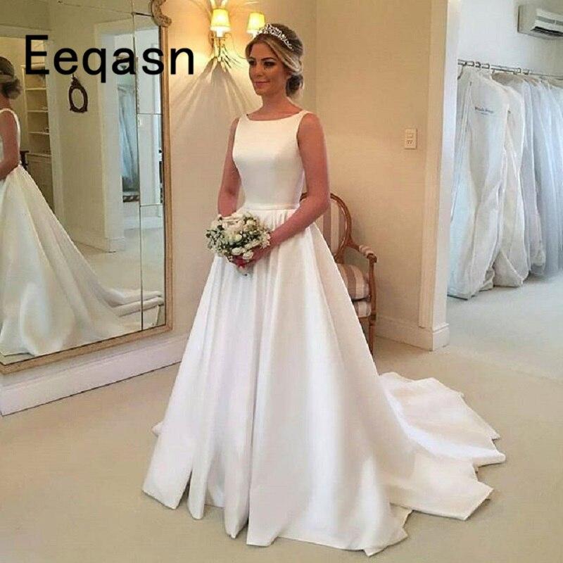 Élégant longue plage robe de mariée 2020 sans manches une ligne Satin blanc robe de mariée en ligne magasin chinois robe de bal rouge