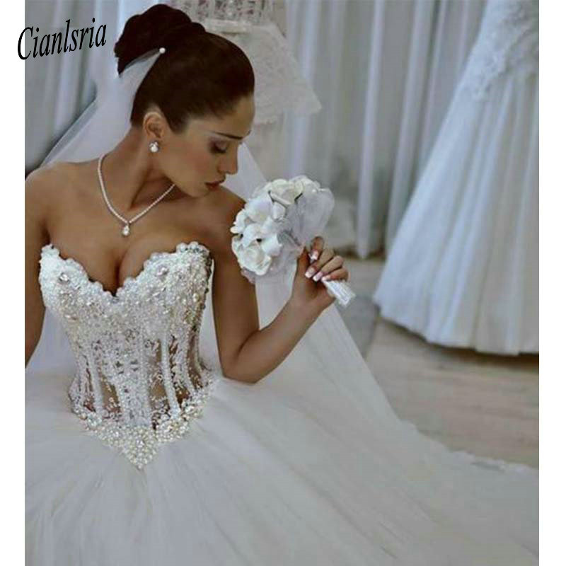 2019 Ball Gown Wedding Dresses Sweetheart Corset See Through Floor Length Princess Bridal Gowns Beaded Lace Pearls