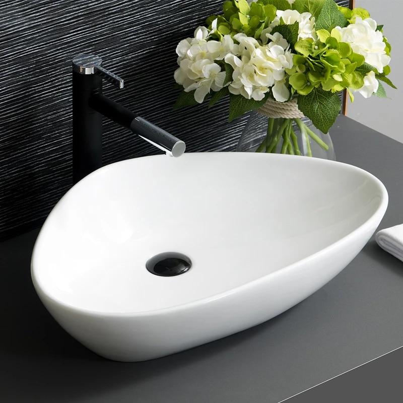 triangle european porcelain ceramic art wash basin counter top basin oval bathroom sinks white