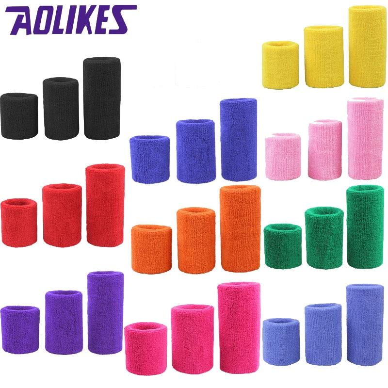 купить AOLIKES 1PCS Tower Wristband Tennis/Basketball/Badminton Wrist Support Sports Protector Sweatband 100% Cotton Gym Wrist Guard по цене 57.8 рублей
