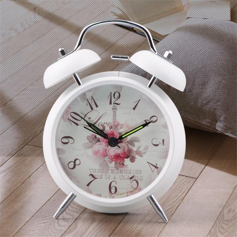 vintage alarm clock with floral pattern background bedside