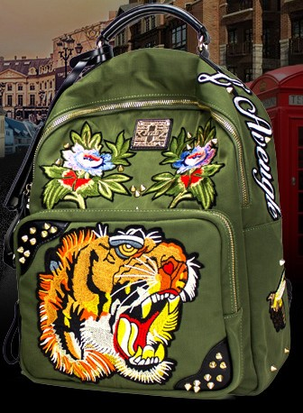 Joker mini backpack rivet Europe and the United States personality canvas bag embroidered backpack europe and the united states male patch slim straight personality five star embroidered hole flanging jeans