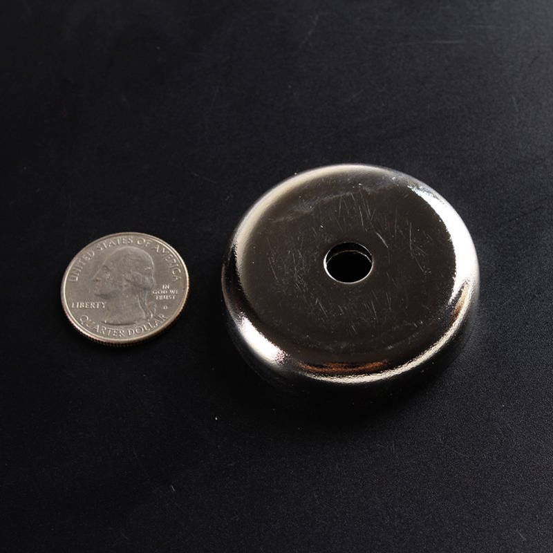 Mounting magnet with a tapered hole that is made by neodymium magnet strong pulling force is 65 KGS the dia is 48mm and 2PCS/lot