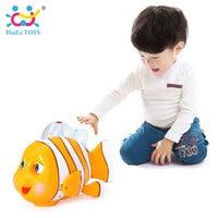 Huileおもちゃ998赤ちゃんのおもちゃ赤外線センサー賢いピエロ魚で音楽&ライト電気おもちゃ子供のための18ヶ月+