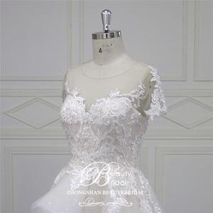 Image 5 - Beautybridal Custom made lace Beads Wedding Dresses round illusion neckline wedding gown short sleeves Vestido de Noiva LS706