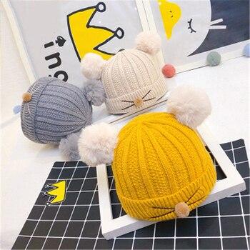 4f8091684 Ideacherry gorros de invierno para bebé recién nacido cálido tejido de lana  de imitación Gorro con 2 Pom doble para niños de 0-3 años
