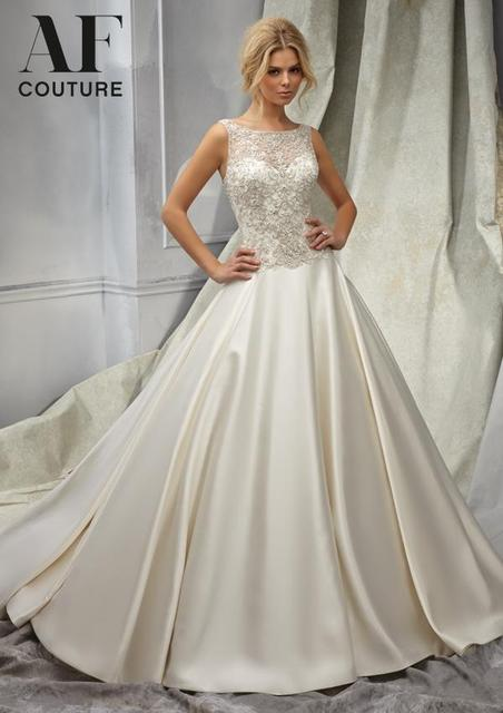 53b27a4229 Hot Sale Country Wedding Dress Tank Sheer Neck Flores Para Noivas Ball Gown  Beading Lace Top Bridal Gowns Low Back Satin NW2902