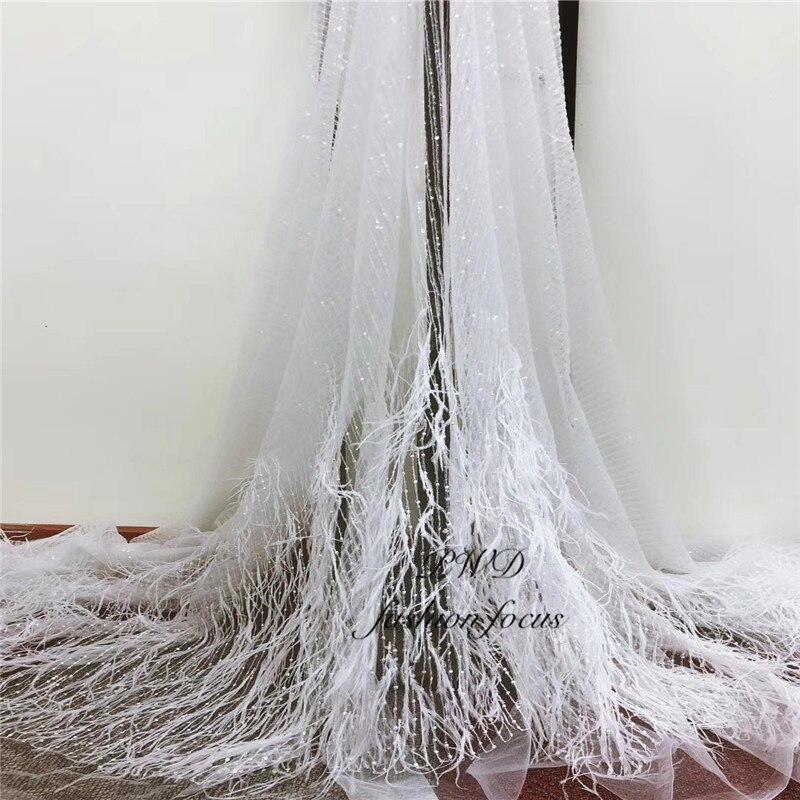 Tissu de dentelle de plume de couleur blanche tissus de haute couture élégant dentelle de mariée en tulle fin