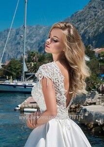 Image 5 - אלילית סאטן O צוואר אונליין חתונת שמלות עם חרוזים תחרת אפליקציות ללא משענת לטאטא רכבת כלה שמלת vestido דה novia