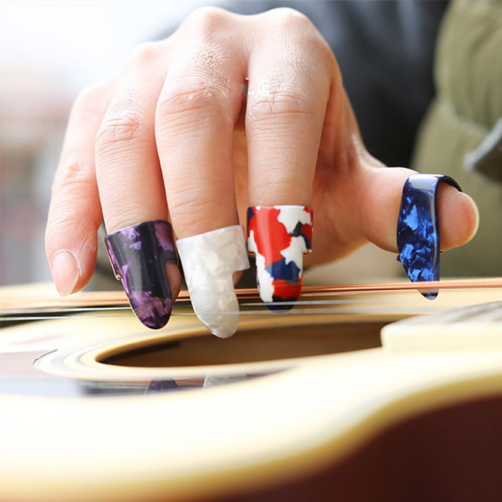 4 db / készlet 1 hüvelykujj + 3 ujjas gitárcsík celluloid - Hangszerek - Fénykép 4