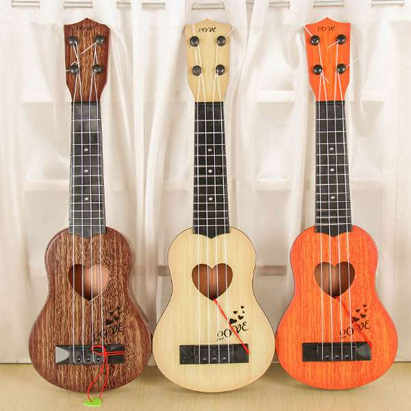Musical Instrument Mini Ukulele Kids Guitar Toys Creative School Play Game Color Random