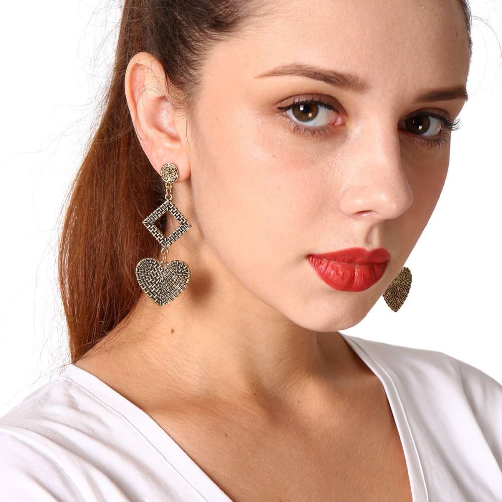 boucle d 39 oreille pompon ethnic style exaggeration alloy carvings heart of the peach retro boucle