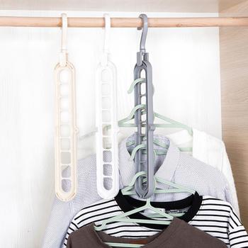 Magia obracające się koło pomocnicze wieszak na ubrania suszarka do prania wieszaki plastikowe przechowywanie w domu wieszaki Dropshipping tanie i dobre opinie Z tworzywa sztucznego Folding hanger Mulitfulcolor Hook Scarf Wraps Shawl Storage Hanger Hook Hangers ABS+PP Dry wet amphibious clothes hanger