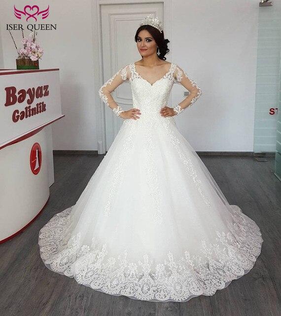 3361e4fe0572 Dubai Illusion Back Long Sleeve Ball Gown Wedding Dress 2019 New White  Ivory Embroidery Pearls Beads Princess Wedding Dresses