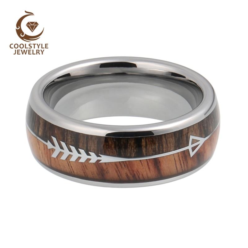 טבעת ממתכת בשילוב עץ וחריטה של חץ 2